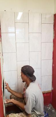 Setting shower tile
