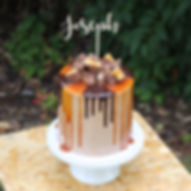 Salted caramel and chocolate cake with custom topper