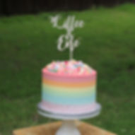Rainbow cake with custom topper