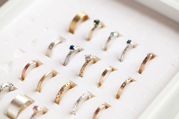 Handmade modern silver and gold rings by
