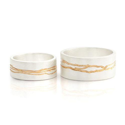 Modern, organic handmade silver rings with gold detail by artisan jewellery designer Kate Smith.