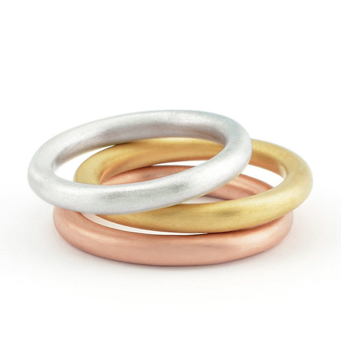 handmade, contemporary silver, rose and yellow gold stacking ring set by Birmingham jewellery designer Kate Smith.