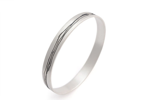 Etched Silver Bangle by contemporary jeweller Kate Smith Jewellery.