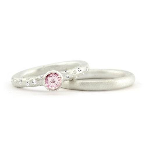 Handmade, bespoke and contemporary pink sapphire and diamond solitaire engagement ring by jewellery designer Kate Smith