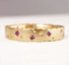 pink diamond and gold eternity ring by K