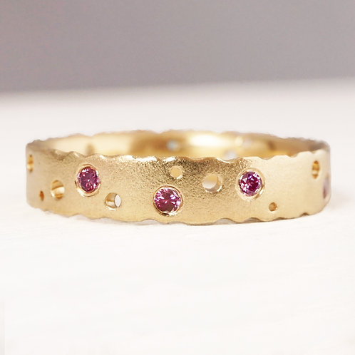 modern artisan eternity, engagement or wedding ring in yellow gold with pink flush set diamonds. By Kate Smith Jewellery, UK