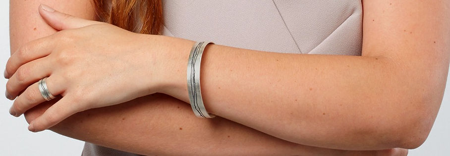 modern silver bangle and ring with oxidised patterningby Kate Smith Jewellery