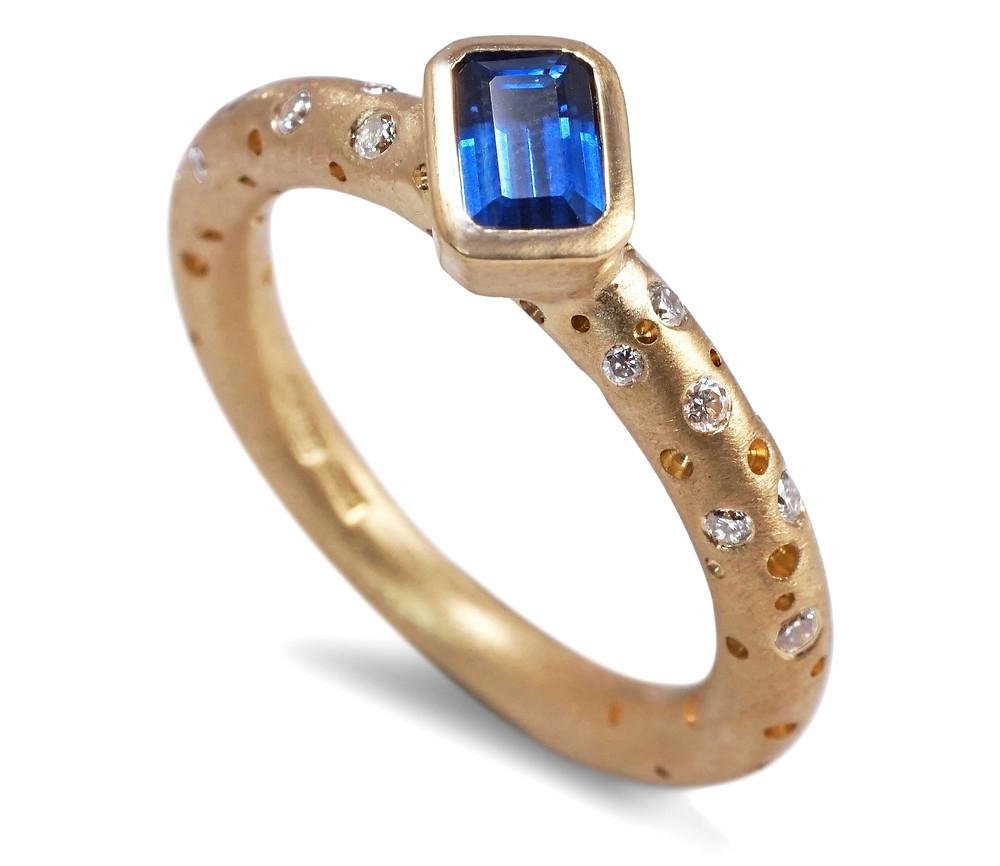 A contemporary blue sapphire ring with flush set diamonds by artisan jeweller Kate Smith, Jewellery Quarter, Birmingham