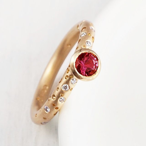 Bespoke, handmade and modern engagement ring. red ruby with brilliant cut diamonds in shoulders. Handmade in Birmingham.