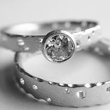 unique solitaire diamond ring with matching wedding ring