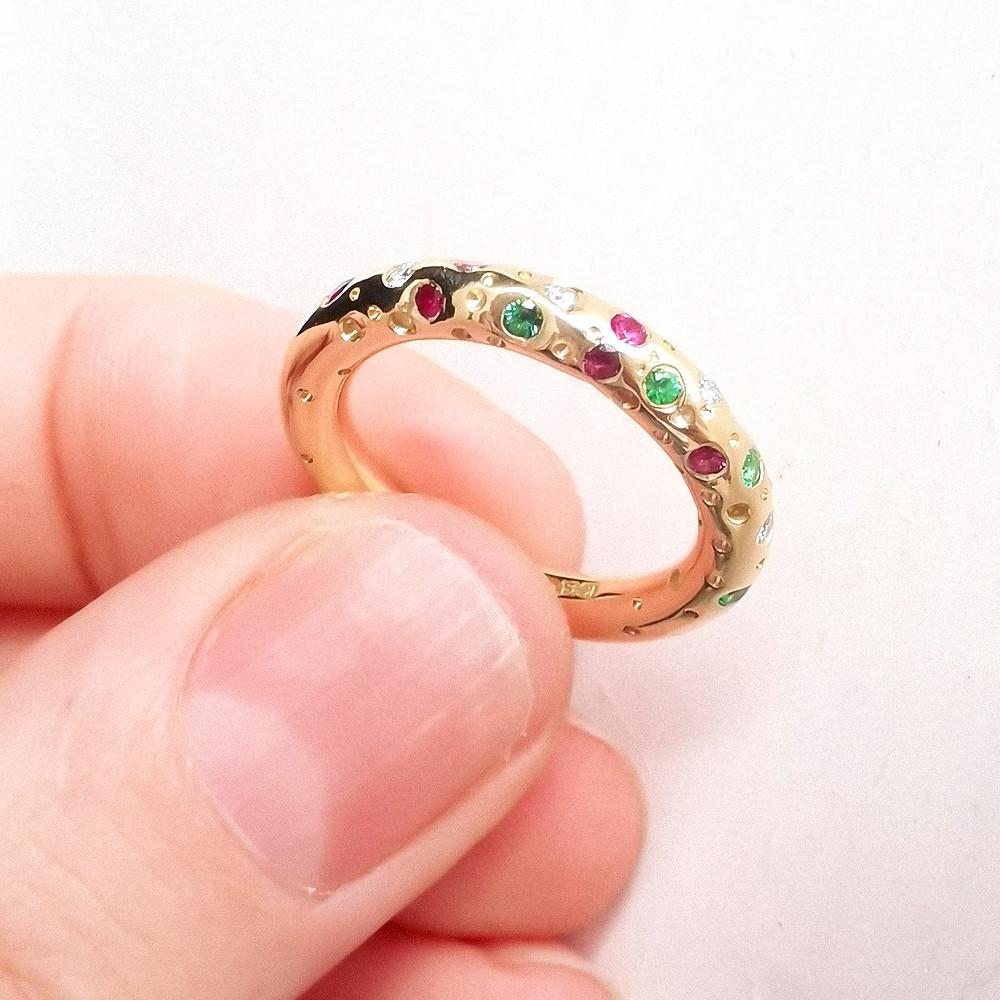 Alternative modern gold eternity ring with multi coloured gemstones by artisan jewellery designer Kate Smith. West Midlands, UK