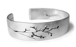 silver cuff with floral detail by Kate Smith Jewellery. Code IS04