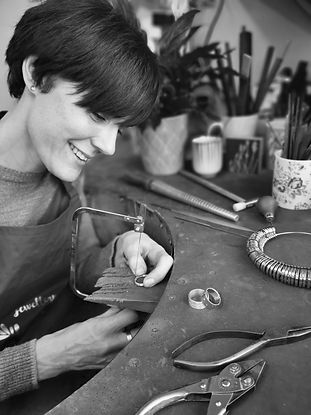 contemporary Birmingham jeweller Kate Smith at her bench handmaking bespoke rings
