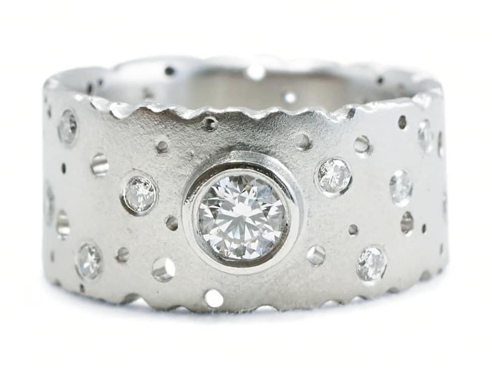 A contemporary upcycled handmade platinum and diamond ring by Birmingham jewellery designer Kate Smith, UK