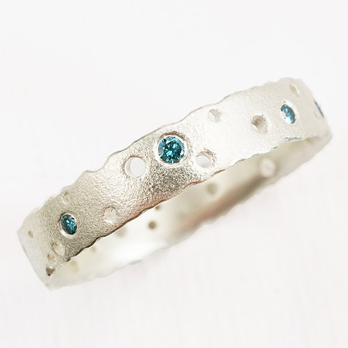 Handmade, unique, bespoke eternity ring with blue diamonds. By Kate Smith, Birmingham, UK