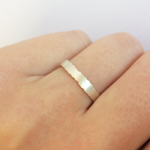 organic handmade silver unique wedding ring with nibbled edges by jewellery designer Kate Smith. Birmingham, UK