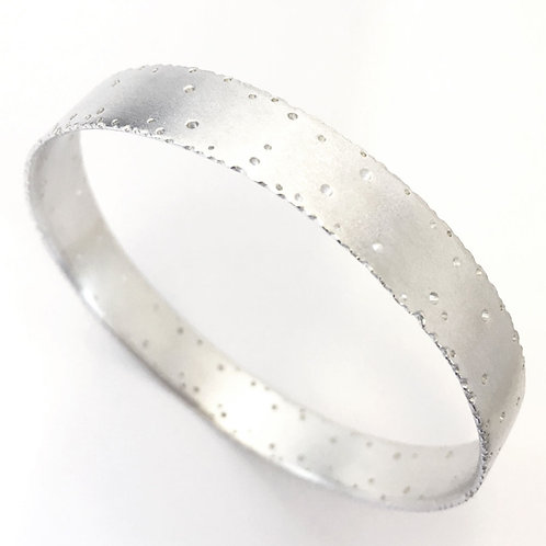 Nibbled Silver Bangle by Kate Smith Jewellery.