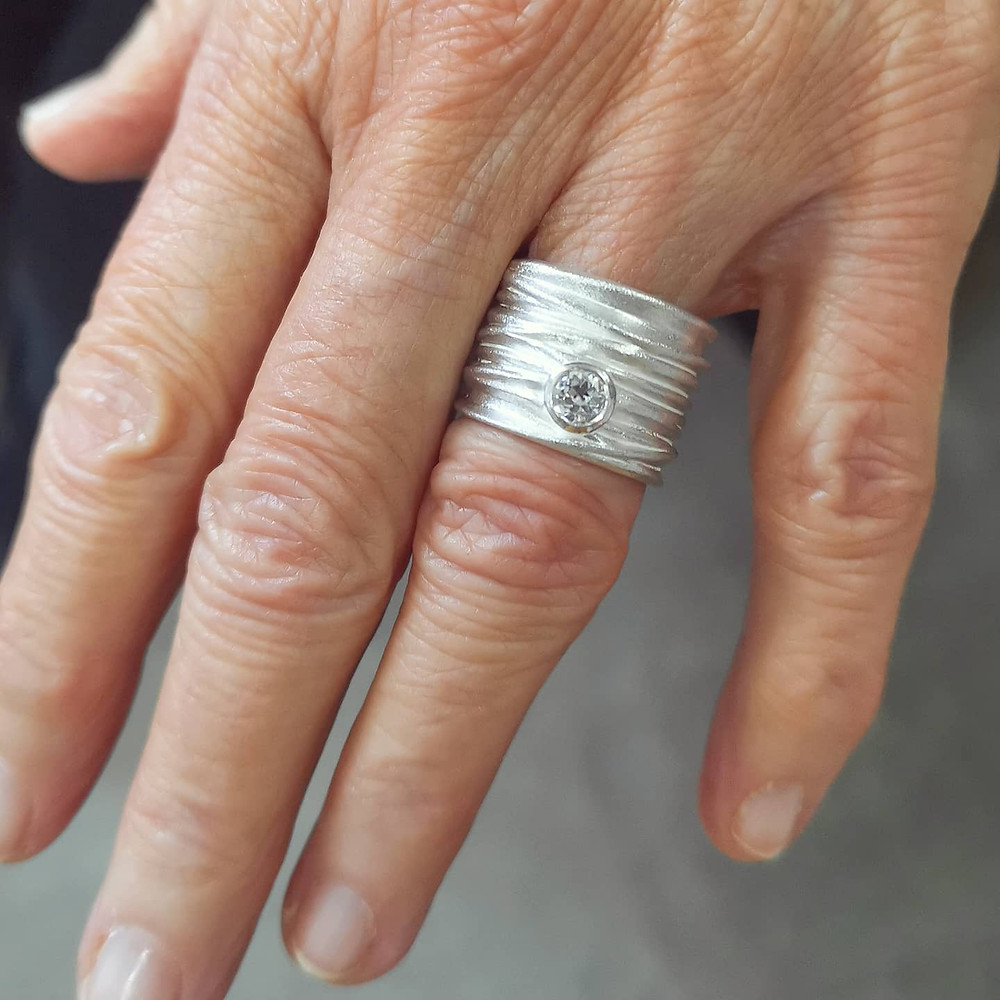 A modern, handmade and contemporary silver and diamond ring created by artisan jewellery designer Kate Smith in Birmingham, UK