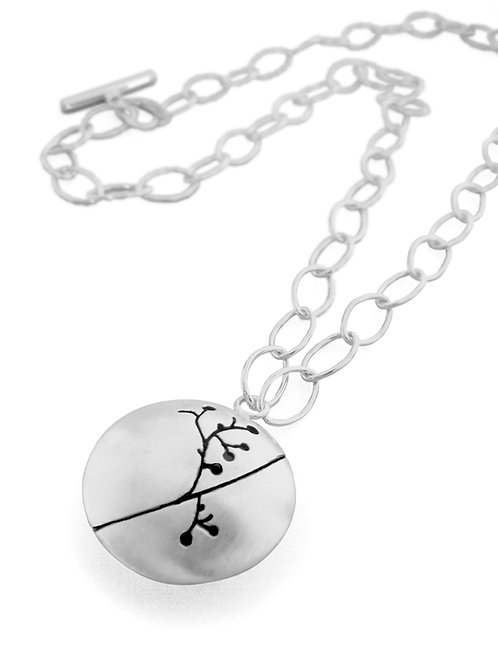 Handmade, contemporary large round silver necklace with floral detail on open silver chain from Kate Smith Jewellery, UK