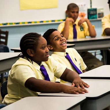 Green Tech 6 grade boys in uniform at their desks