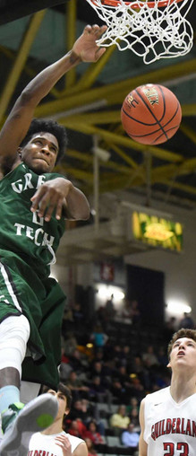 Green Tech player still in air after successful dunk