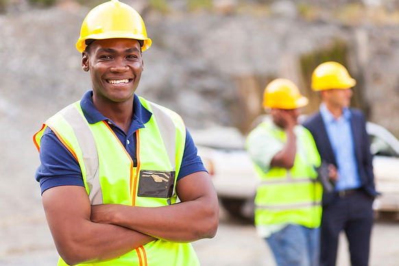 African American industrial worker with arms crossed.jpeg