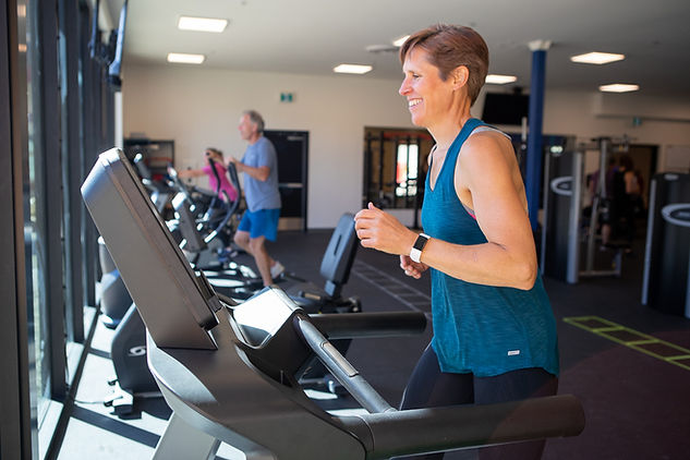 Women running on treadmill.