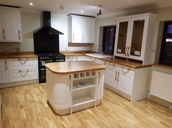 Shaker style kitchen with oak work surface and flooring