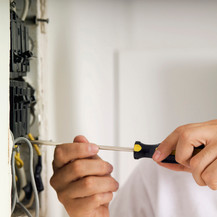 electrical contractor working on panel