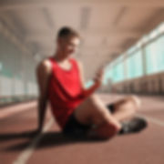 man-in-red-tank-top-and-black-shorts-sitting-on-running-3763865_edited.jpg