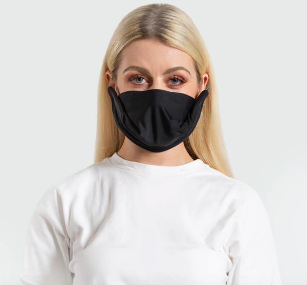 woman wears trtl face mask in black