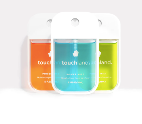 power mist hydrating hand sanitizer in three scents which are orange, blue, and green from touchland