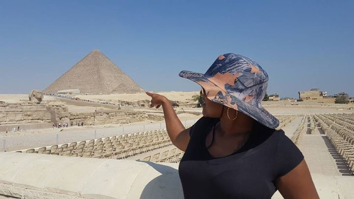 In front of the Sphinx and Pyramids