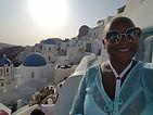 ashawna lane greece oia santorini europe thira travel blog black woman international abroad fashion sunglasses blue white dentist