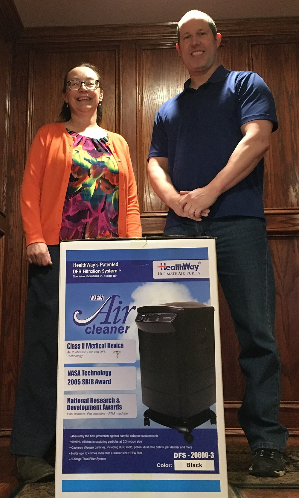 Photo of Teresa Woolson and JD Damon Jr. with the Air Purifier.