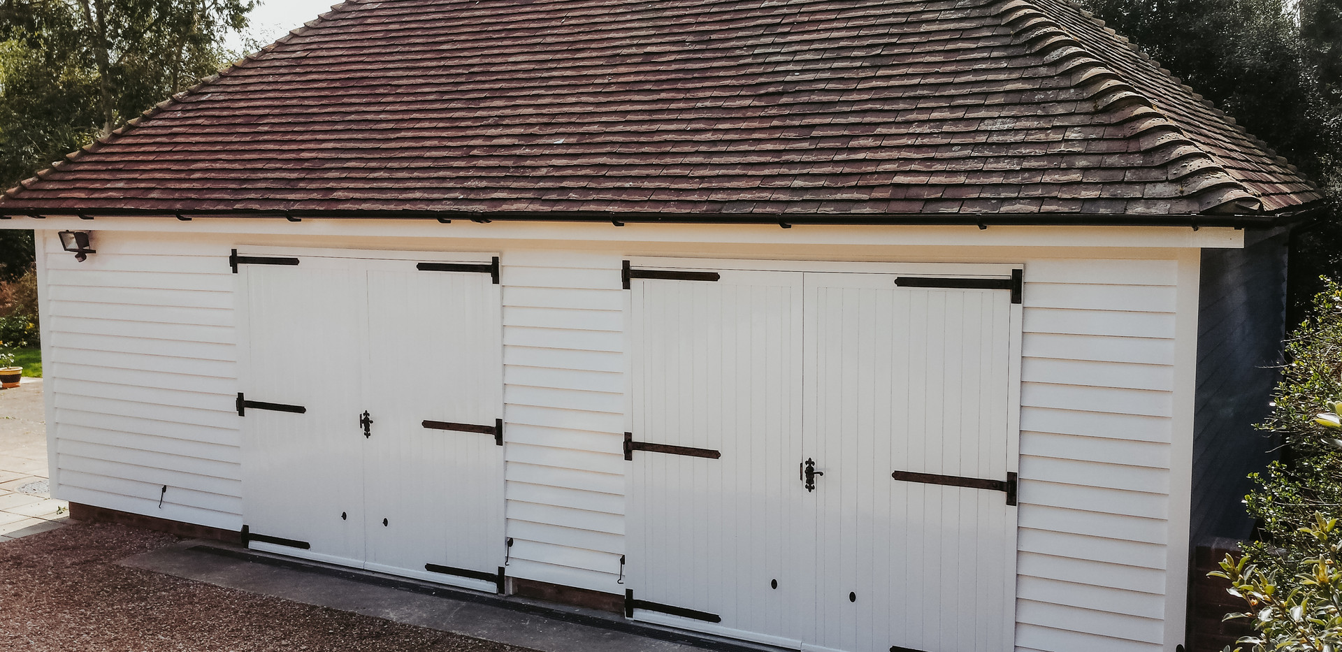 White painted timber double garage