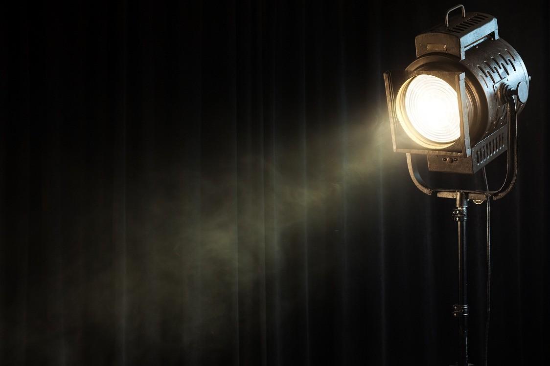 vintage-theatre-spot-light-on-black-curt