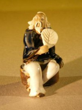 Man Holding a Fan Sitting on a Rock Miniature Figurine