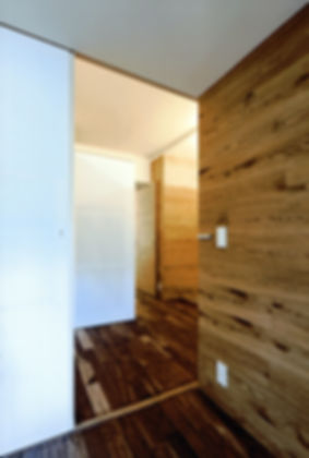 深江の家 改装 リフォーム 住宅 マンション 1階 RC コンクリート造 兵庫県 神戸市 シンプル ナチュラル モダン 廊下 関西  自然素材 壁に木板張り