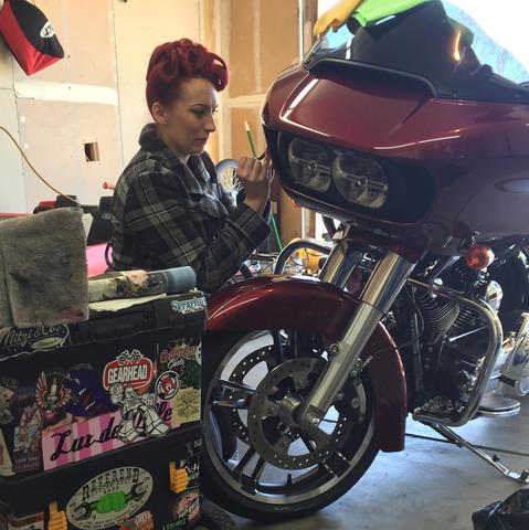 Trisha working on the Harley