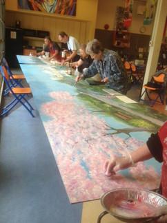 AFAA Members Painting Mural