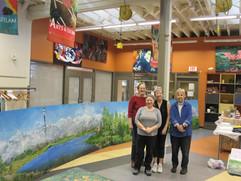 Members In Front of Mural