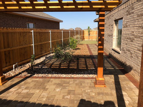 Opposite view of cedar pergola with walkway leading to backyard.
