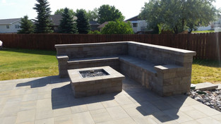 Gas burning firepit with paver benches to enjoy the evenings.