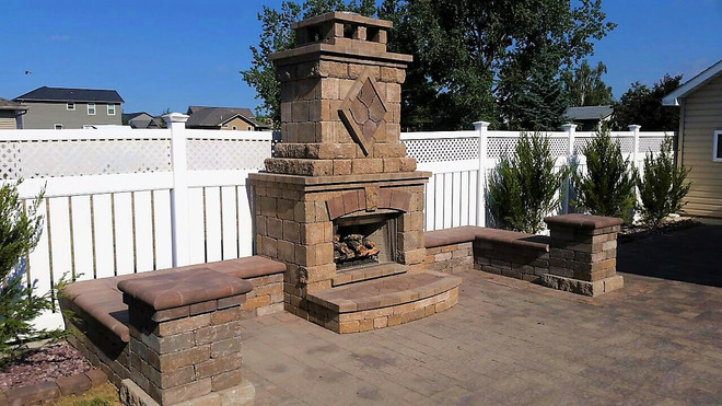 This eye catching fire & hearth with paver seating and patio is a fun way to enjoy your backyard.