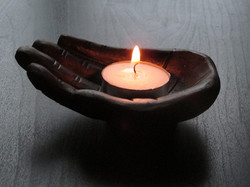 Canva - Zen Candle on a Wooden Hand Carv
