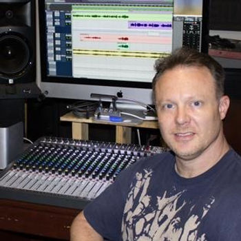 Brian in his studio next to his Soundcraft Signature series console