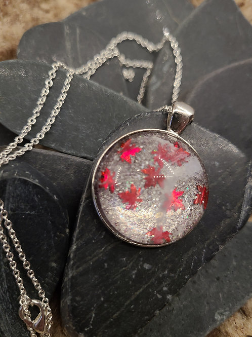 Red leaves in glass/metal medallion