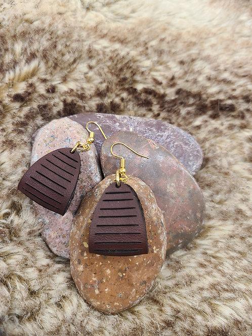 Leather loop/slit cut earrings
