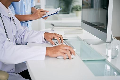 doctor-working-on-computer-BHVRAXA.jpg